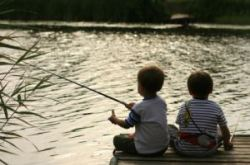 boys fishing at a cottage dock